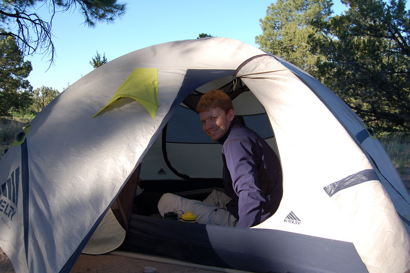 Roderick in our tent, Bandelier National Monument, NM.