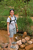Michelle bravely crossing a stream in Negro Bill Canyon, Moab, UT.