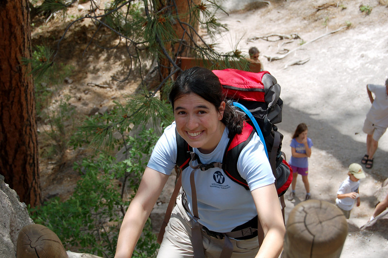 Michelle fearlessly climbing ladders to the Ceremonial Cave at Bandelier National Monument, NM.