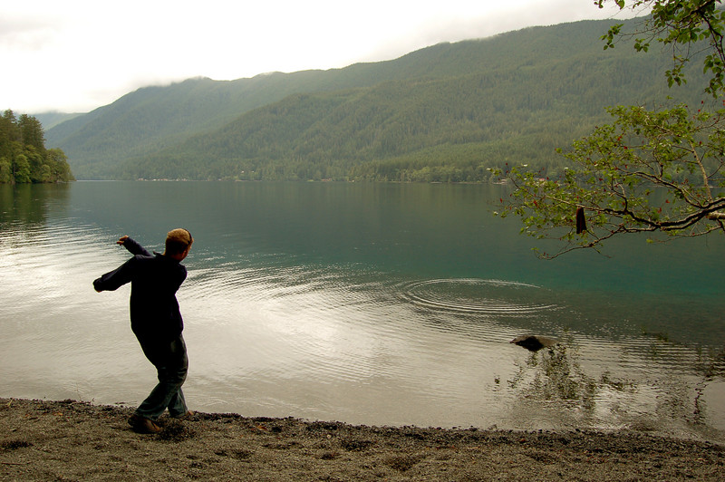 Rod skipping stones on Lake Crescent, Olympic National Park, WA.