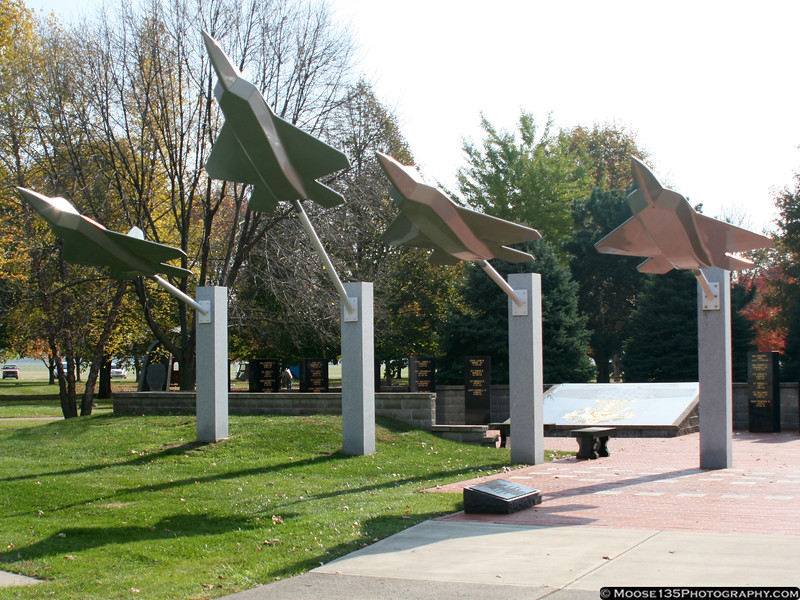 """F-22 """"Missing Man"""" sculpture, with memorial to USAF recipients of the Medal of Honor."""