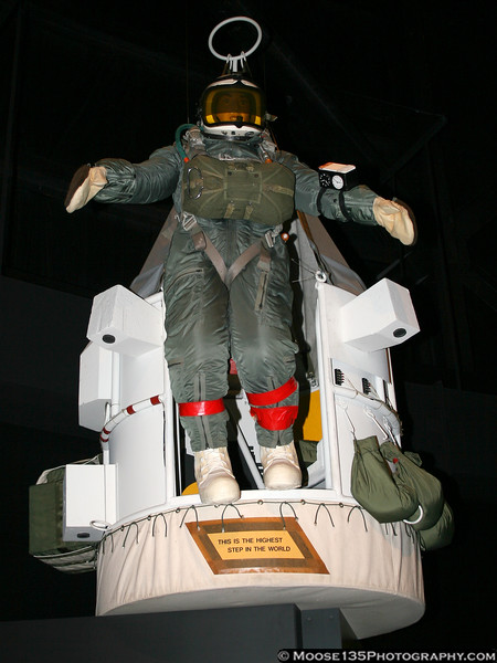 This display recreates the work of Capt. Joseph Kittinger, USAF. As head of Project Excelsior in the late 1950s and early 1960s, he made several high altitude parachute jumps from this balloon gondola to develop escape systems for high performance aircraft. His final jump, August 16, 1960, was from 102,800 feet (almost 20 miles above the Earth!) He had a 4 1/2 minute free fall until the parachute opened at 17,500 feet, and during this he reached a speed of 714 mph - faster than the speed of sound!
