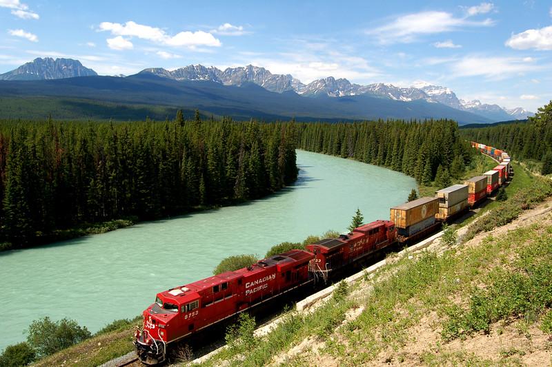 Freight train passing through Banff National Park, Canada.