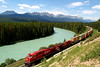Freight train passing through Banff National Park, Canada.