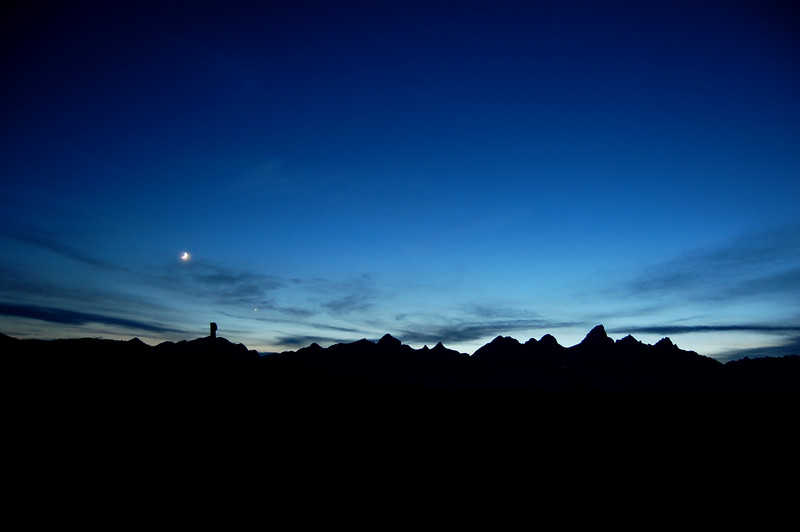 The moon over the tetons, Teton National Park, WY.