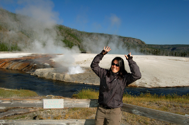 Michelle in front of Cliff Geyser, Yellowstone National Park, Wyoming.