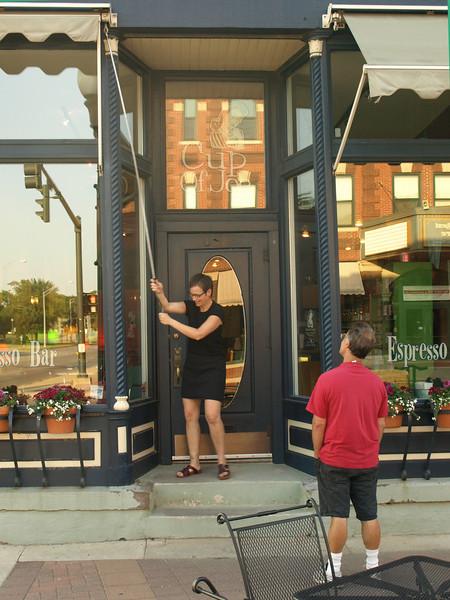 Waiting for the coffee shop to open, Cedar Falls, Iowa, July 5, 2008.