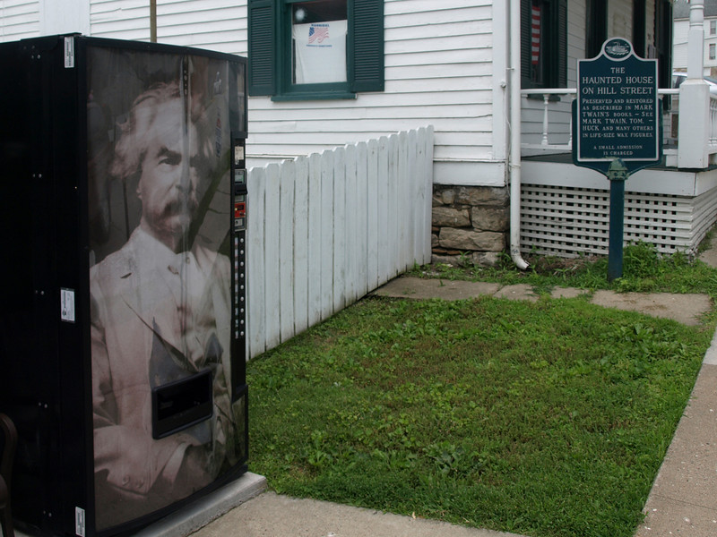"Mark Twain soda machine at left, ""historic"" haunted house at right. Hannibal, Missouri, June 24, 2008."