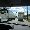 Semis crowd narrow streets of Davenport, Iowa, detour.