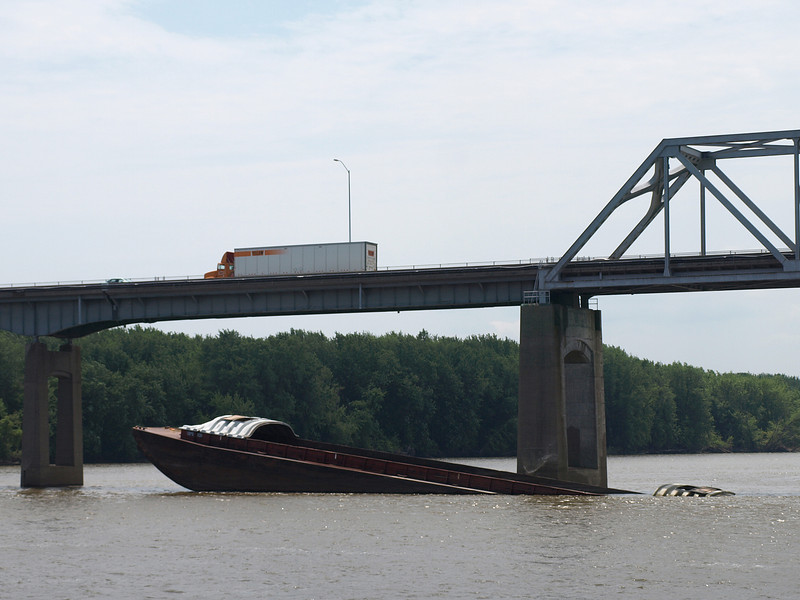 The Mississippi River is still a dangerous place; this barge carrying grain sank only three weeks ago.