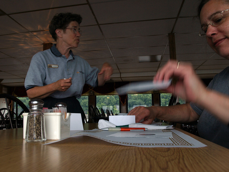 Juley writes postcards to Iraq while crew member explains lunch (cold cut sandwiches) on board the SPIRIT of Dubuque, July 2, 2008.