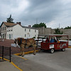 Horse drawn trolley, Hannibal, Missouri, June 24, 2008. Mark Twain's boyhood home is white building at center left.
