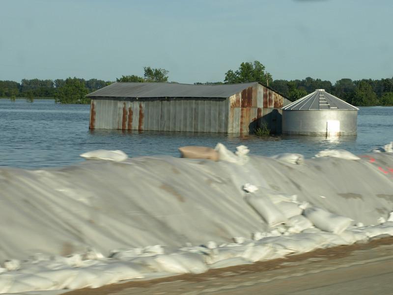 Sandbags keep the flooding Mississippi River off of Route 61, near La Grange, Missouri.