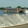 Sandbags keep the flooding Mississippi River off of Route 61, near La Grange, Missouri.