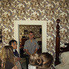 Park Ranger explains the wallpaper in Mr. Lincoln's bedroom.