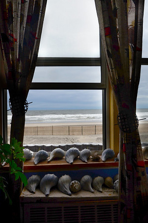 Paul's windows look out to the Atlantic Ocean. Some kinda front yard, ya think? And no grass to mow.....
