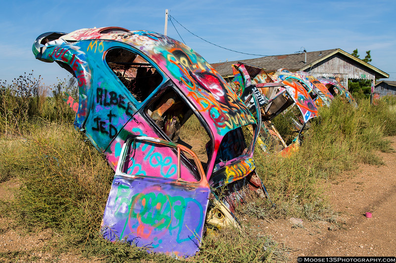 Inspired by the Cadillac Ranch, the Slug Bug Ranch in Conway, Texas features VW Beetles nose first in the ground.