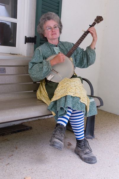 One of the boat workers playing the banjo