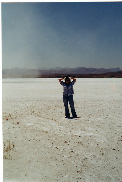 Mali standing in the Lower Pahranagut Lake bed, Nevada. <br /> June 18, 2002