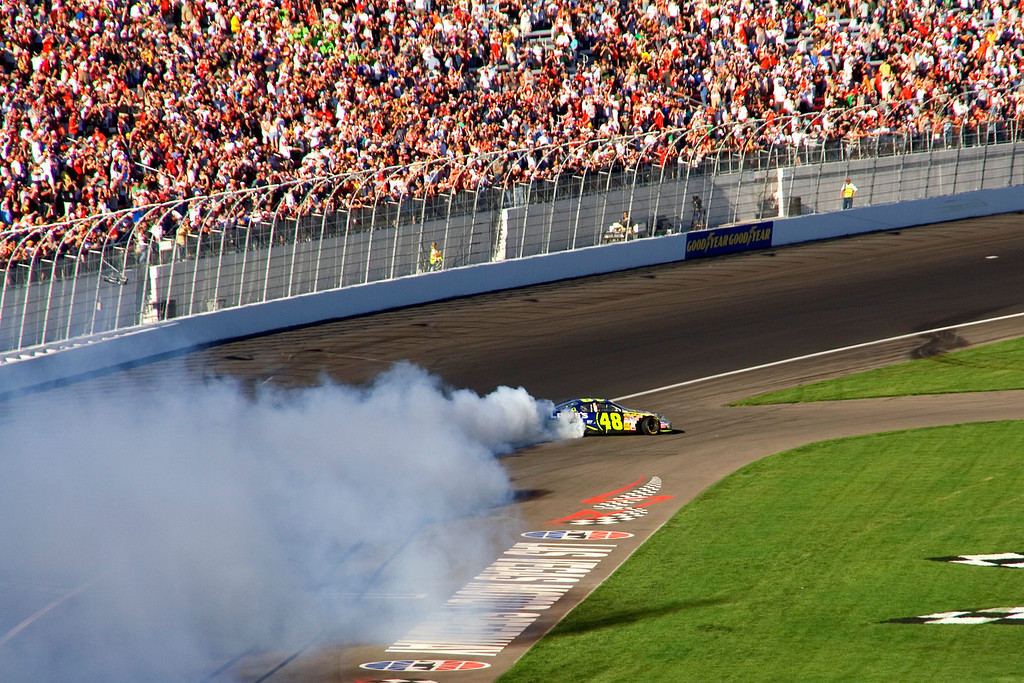 Jimmie Johnson pulls a few donuts after winning the UAW-DaimlerChrysler 400.