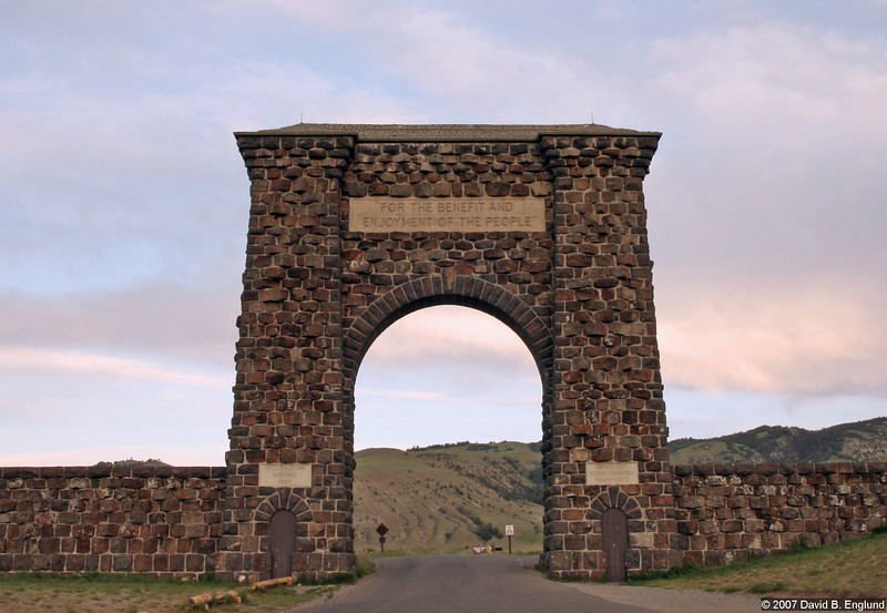 "Yellowstone National Park North Entrance (Gardiner MT):<br /> <br /> # The Arch is 50 feet high<br /> # The main opening is 30 feet high by 25 feet wide<br /> # Each tower is: 12 feet square at the base, tapers to 6 feet where Arch begins<br /> # The rocks were hewn from basalt, a volcanic rock, quarried locally<br /> # Cost for the Arch was $ 10,000.00<br /> # Above the arch is carved: ""For the Benefit and Enjoyment of the People""<br /> # On east tower is carved: ""Yellowstone National Park""<br /> # On the west tower is carved: ""Created by Act of Congress, March 1, 1872""<br /> # President Theodore Roosevelt was already in the park on vacation when asked to lay the cornerstone<br /> # Several thousand people came to Gardiner - mostly by train - on April 24, 1903 for the dedication"