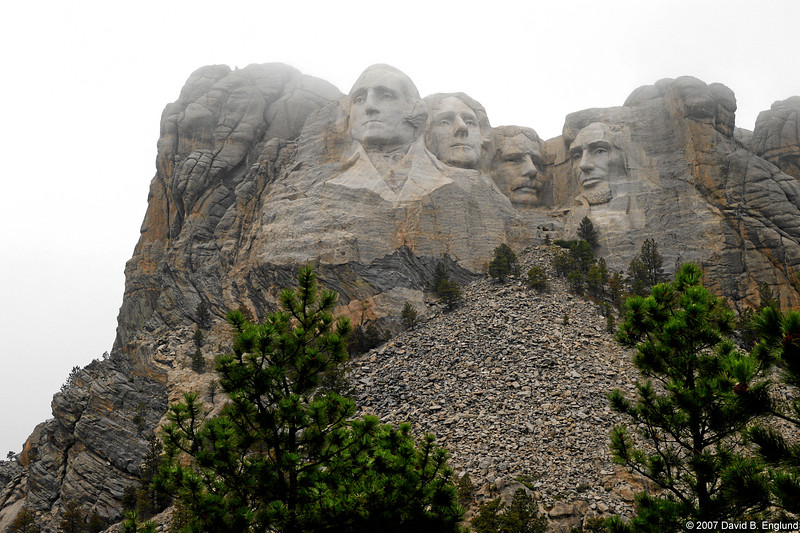 """""Mount Rushmore is a memorial that symbolizes America, and Americans should never lose sight of their cultural beginnings."" -Gerard Baker, Superintendent.""  ""<a href=""http://www.nps.gov/moru/index.htm"">Mount Rushmore National Memorial</a> is host to almost three million visitors a year from across the country and around the world. They come to marvel at the majestic beauty of the Black Hills and to learn about the ideals of democracy and freedom represented by the granite portraits of Washington, Jefferson, T. Roosevelt, and Lincoln. Over the decades, Mount Rushmore has grown in fame as a symbol of America -- a symbol of freedom and democracy and a hope for people from all cultures and backgrounds.""  Because of time constraints I was not able to visit Mount Rushmore on my first leg Westward toward Yellowstone. On my Eastward return trip home I realized I had some extra time in the schedule, so a visit to the four honorable gentlemen was in order!"