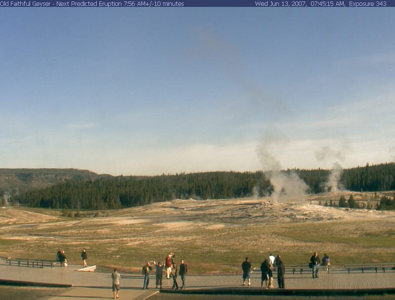 Yours truly is on the right side of the image, in blue jeans and brown sweater, facing the webcam. Note the time - 7:45 AM.