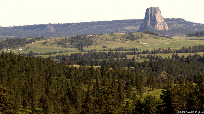 """<a href=""""http://www.nps.gov/deto/"""" target=_blank>America's First National Monument</a>  """"Devils Tower rises 1267 feet above the Belle Fourche River. Once hidden, erosion has revealed Devils Tower. This 1347 acre park is covered with pine forests, woodlands, and grasslands. Deer, prairie dogs, and other wildlife are seen.  Also known as Bears Lodge, it is a sacred site for many American Indians.  President Theodore Roosevelt proclaimed Devils Tower the first national monument in 1906."""""""