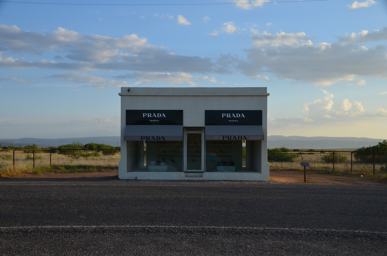 """""""Prada Store"""", an unexpected and apparently well known art project by Elmgreen and Dragset on the outskirts of Marfa, TX. Contained the full 2005 fall/winter collection, but no cashiers."""