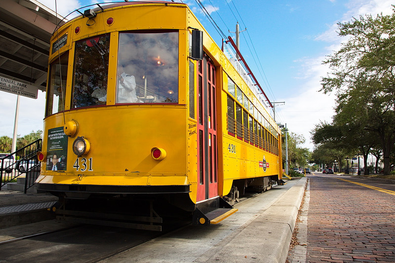 088 A TECO (Tampa Electric COmpany) trolley. This photo was taken in full sunlight under a blue sky, so the bright marigold trolley just overflows with color. And yeah, I boosted it a little to create a vibrant, sunny image. It's all fun. Oh, and the trolley is at the end of its line; that's why the tracks don't extend behind it.