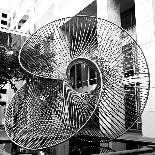 231 A stainless-steel sculpture in a courtyard seems to float above a pool. If you walk 360 degrees around this sculpture you'll be treated to at least 360 different sculptural views.