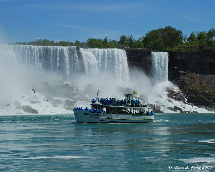 American Falls from the dock area with a boat from the US side coming back