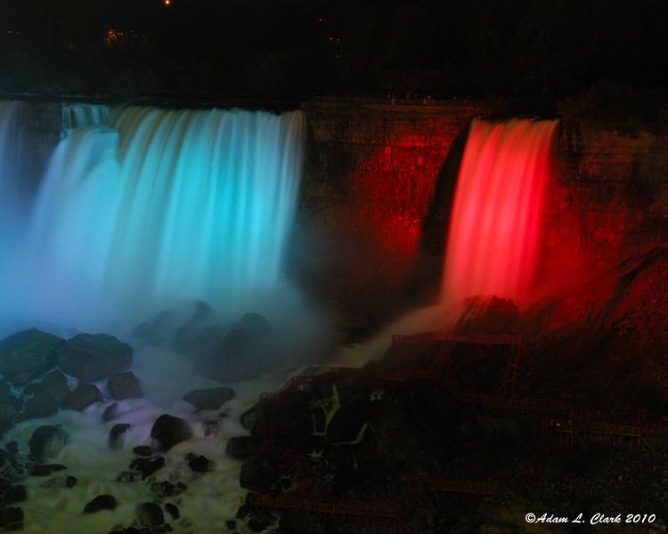 American Falls and Bridal Veil Falls illuminated at night