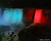 American Falls and Bridal Veil Falls illuminated at night
