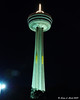 Skylon Tower at night.  The yellow blurs are the elevators