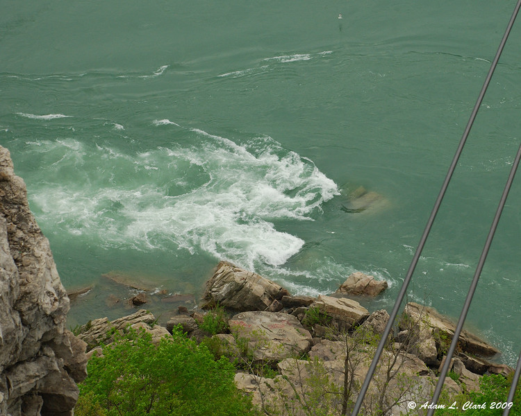 Rough water going over rocks while leaving the whirlpool