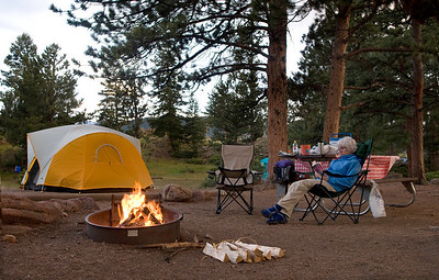 Our campsite in the Moraine Park Campground, Rocky Mountain National Park, Colorado. Enjoying a book and an evening fire.