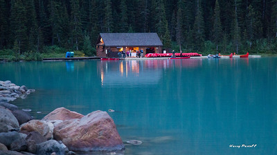 Lake Louise at dawn and already folks are getting ready to do canoeing