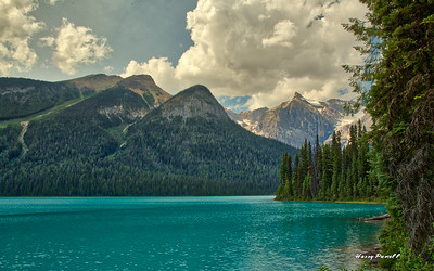 Emerald lake with mountains, and HDR photo.