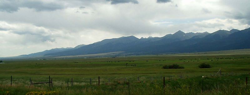 The Crestone Peaks of the Sangre de Cristo, near Wolf Creek Ranch. Storms are coming.