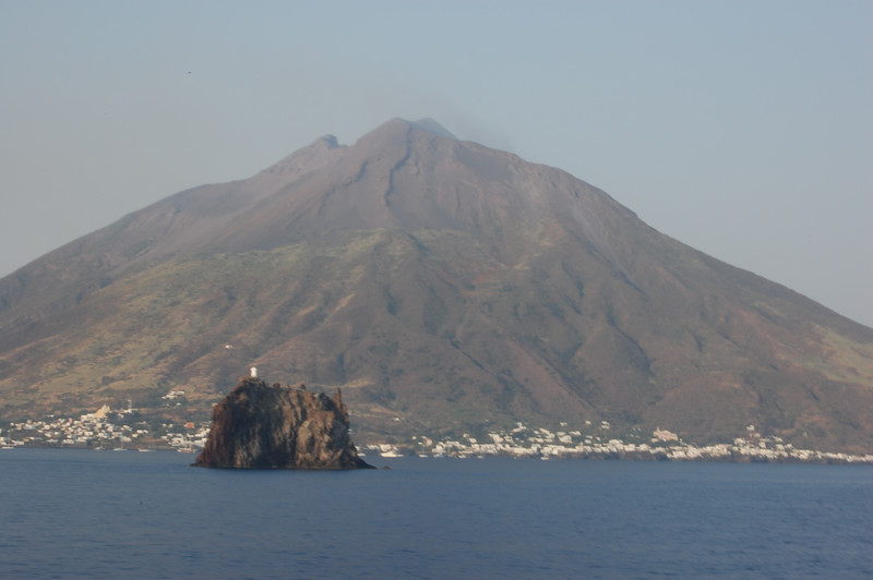 #14  Day 2, 08/30/07.  Stromboli Island with its volcano.  Note the fumes near the top of the volcano just to the right of the top.  How would you like to live below!