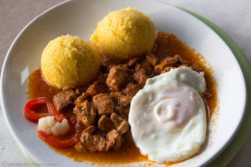Tochitura: three types of pork in tomato sauce side of polenta