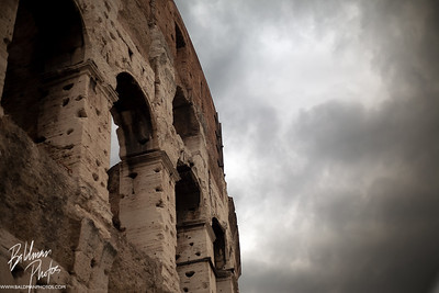 Colosseum with foreboding clouds
