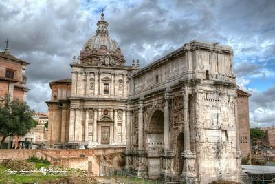 Arch of Septimius Severus and Santi Luca e Martina church, Roman Forum, Rome, Italy, March 11, 2013
