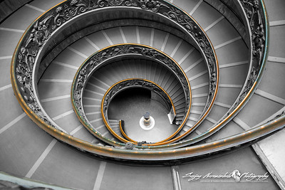 In Black & White - The Vatican Museums spiral staircase is one of the most photographed in the world, and certainly one of the most beautiful. Designed by Giuseppe Momo in 1932, the broad steps are somewhere between a ramp and a staircase. The stairs are actually two separate helixes, one leading up and the other leading down, that twist together in a double helix formation. Little did the Vatican Museum know in 1932 that this formation would come to represent life itself, with the discovery of the double helical DNA strand. Vatican City, March 13, 2013