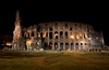 Wide angle view of the Colusseum at night. The Rome streets turn strangely quiet by 9PM.