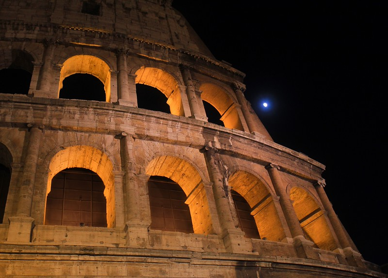 Moon behind the Colusseum.