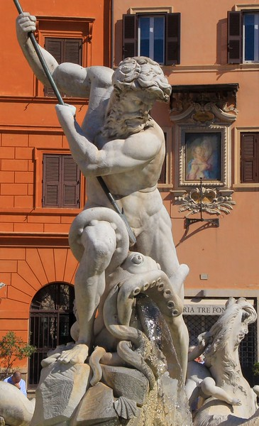 Vertical crop of Neptune in his fountain.