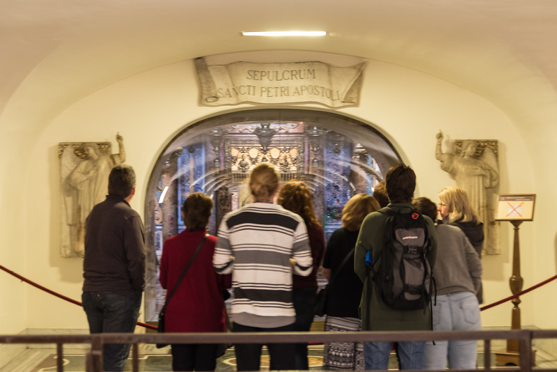 Vatican City - St. Peter's Basilica, St. Peter's crypt: tourists viewing tomb of St. Peter