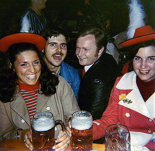 """September 24th-27th, 1970 / Oktoberfest Trip:  At a """"proper"""" Munich beer hall. L to R: Carol Landini, myself, Wolfgang, our new German friend, and Anita Quish enjoying one of many liters we drank that night. And why not?  German beer was smooth and delicious, and the ten major breweries trotted out their best at the annual Fest."""